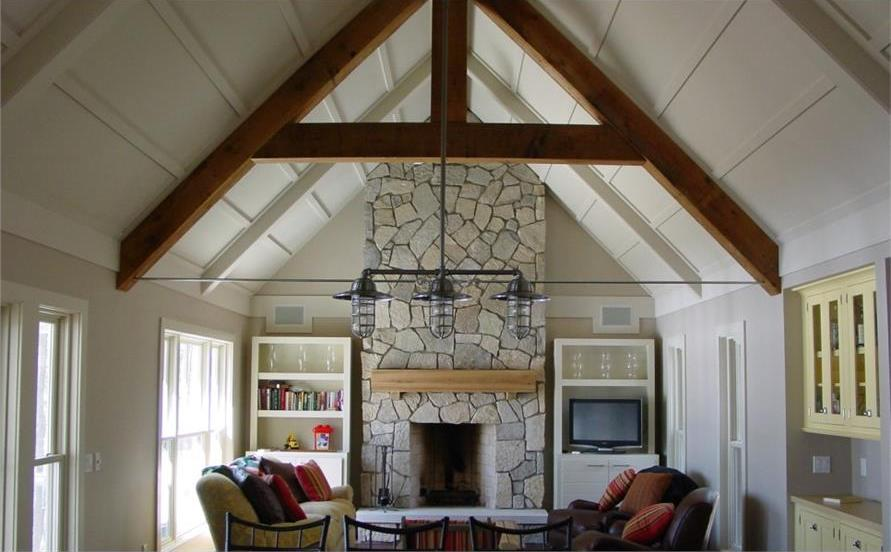 Vaulted ceiling with natural timbers in Great Room of Vacation style home