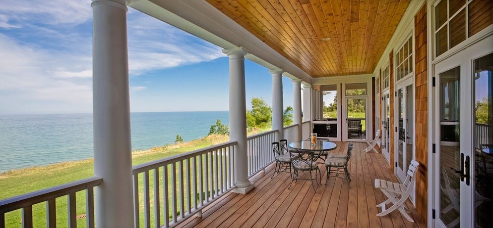 Covered rear porch of Shingle style home
