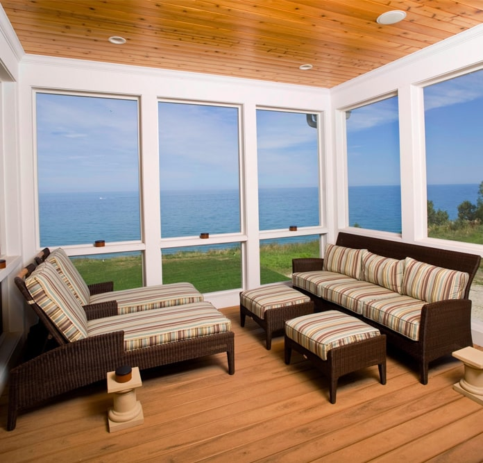 Enclosed deck of a 2-story, 5-bedroom, 5-bath Shingle style home
