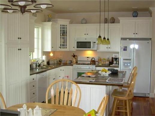 Homey kitchen with breakfast area and kitchen island