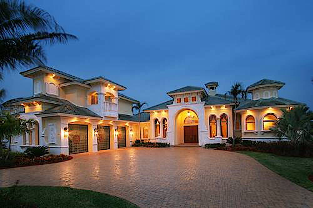 Luxury Mediterranean style home with 3-car garage, tile roof, and stucco siding