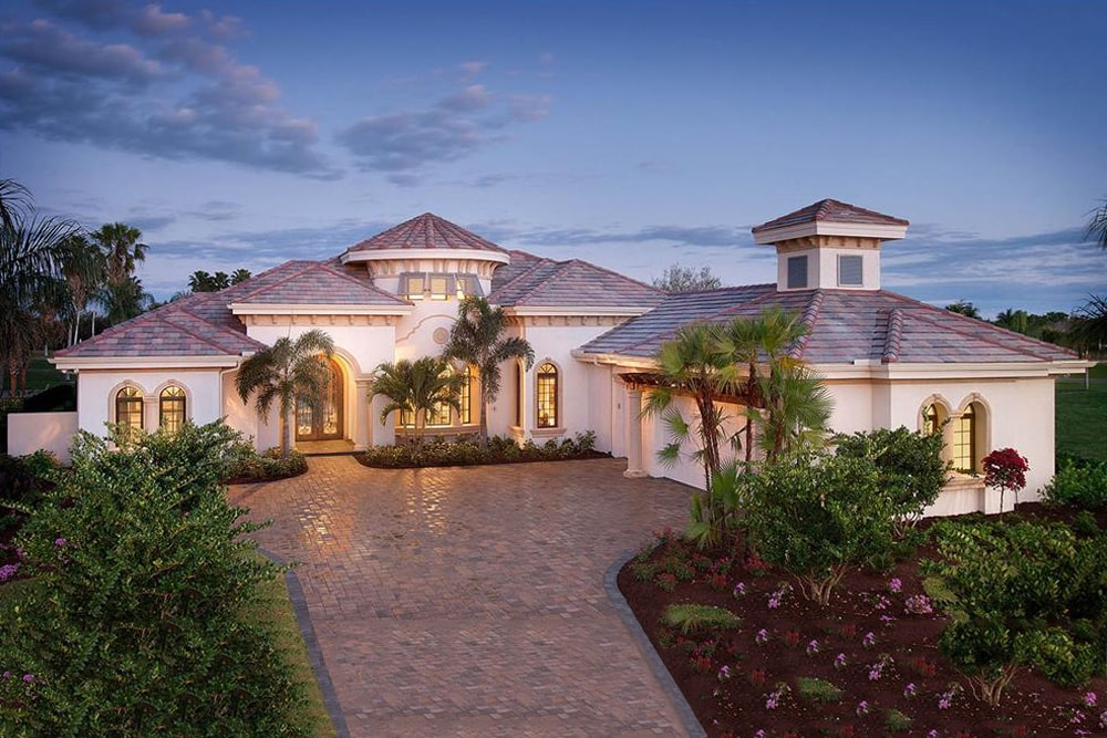 Florida coastal style home with hip roof design and stucco siding