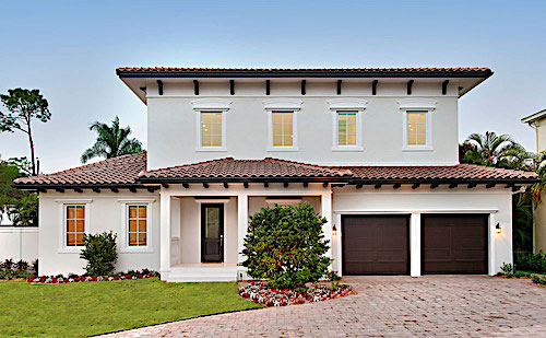 White stucco Coastal home with Spanish influences