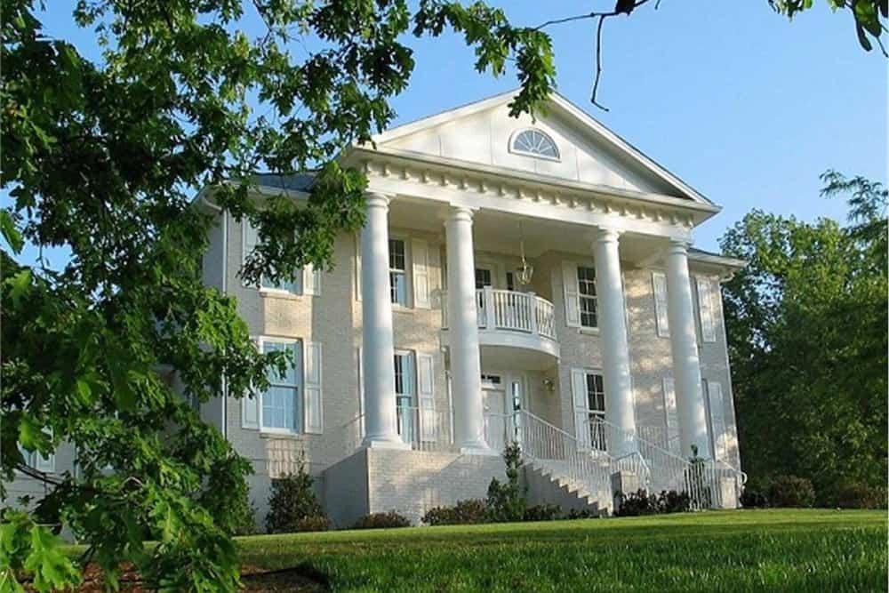 impressive manor home with four-column portico