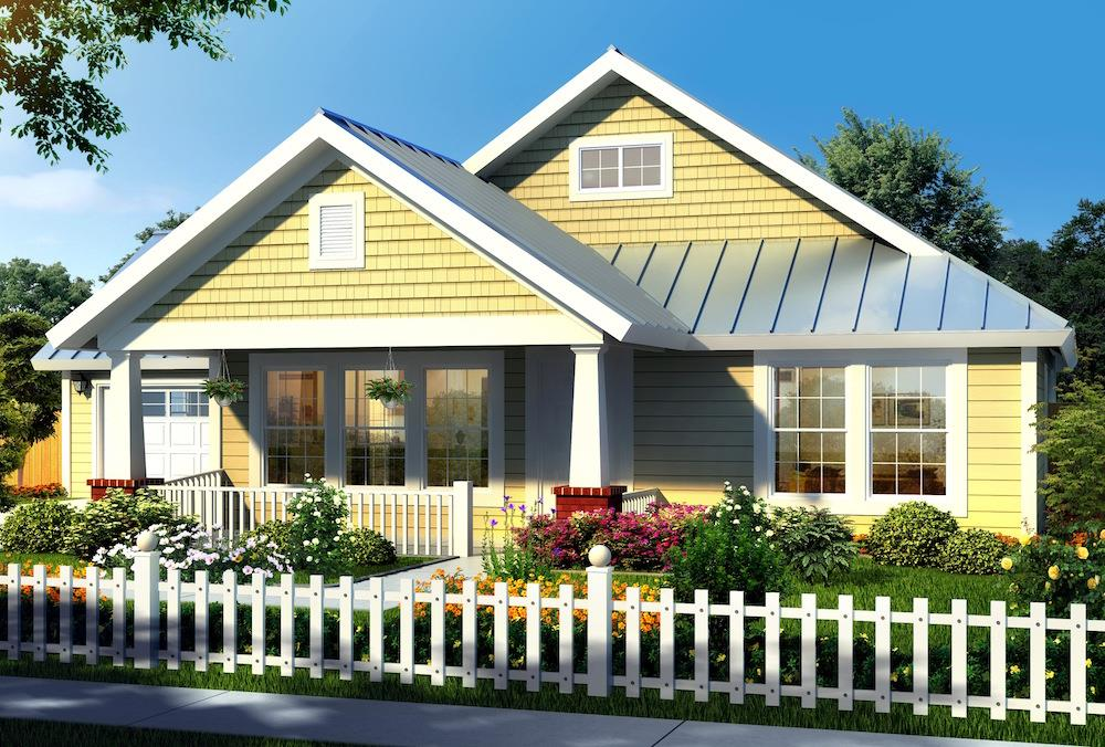 Small house with 3 bedrooms and 2 baths that is sided in yellow shakes and clapboards