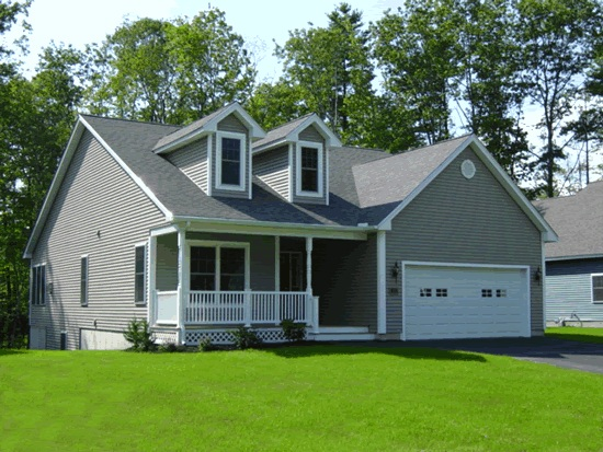Gray Cape Cod style house with two dormers and front porch