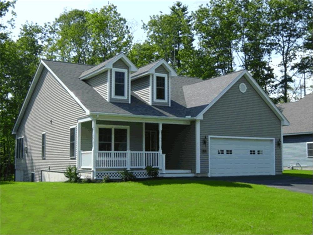 44-foot-wide 2-bedroom home with gray siding, a covered front porch, and two dormers