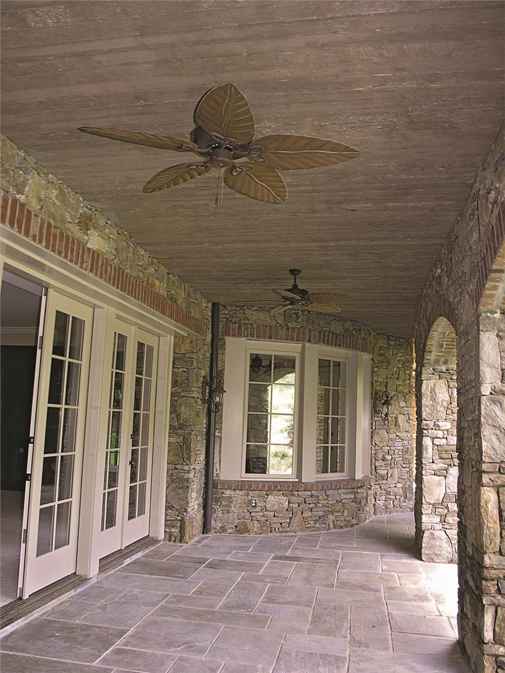 Porch with brass ceiling fan in House Plan #180-1025