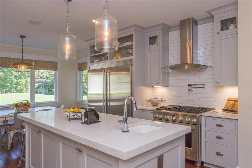 Sleek, modern kitchen with bubble-like light fixtures