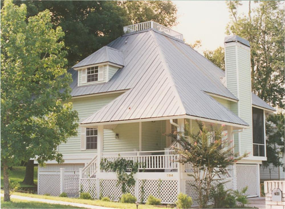 Steep hip metal roof make House Plan #190-1001 highly resistant to wind