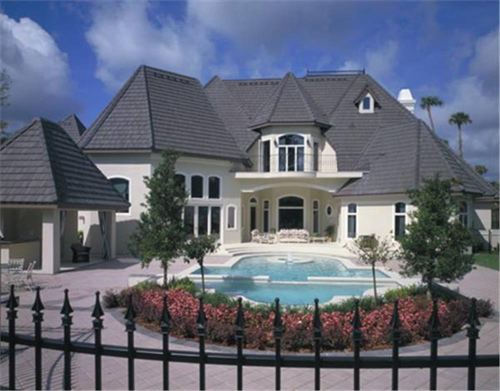 large patio and swimming pool for a 5-bedroom, 5-bath, 3-half-bath French chateau
