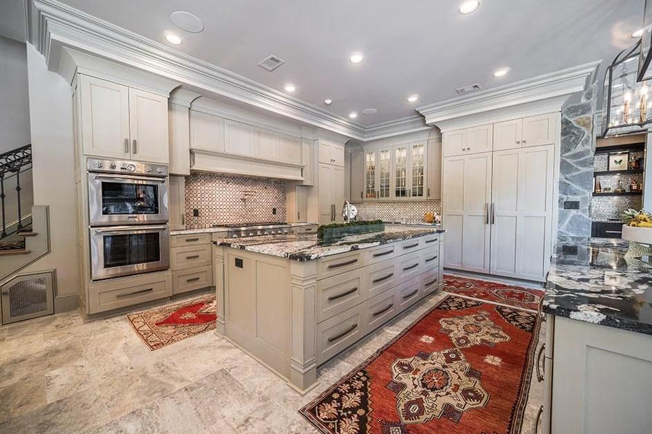 Clean, classic white kitchen with crown molding on the ceiling