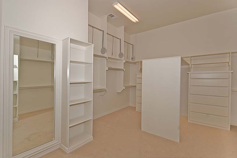 Master walk-in closet in house plan #195-1005