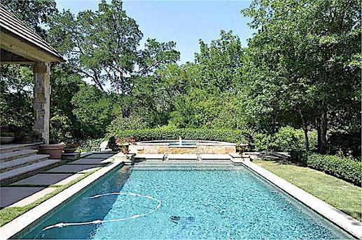 Classic rectangular pool that's a retreat in a garden setting