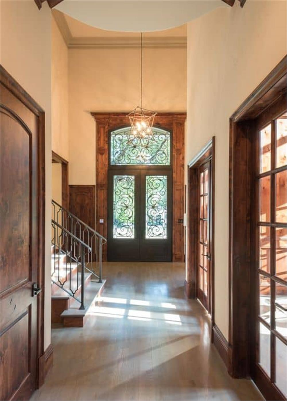 Foyer with high ceiling and decorative front door