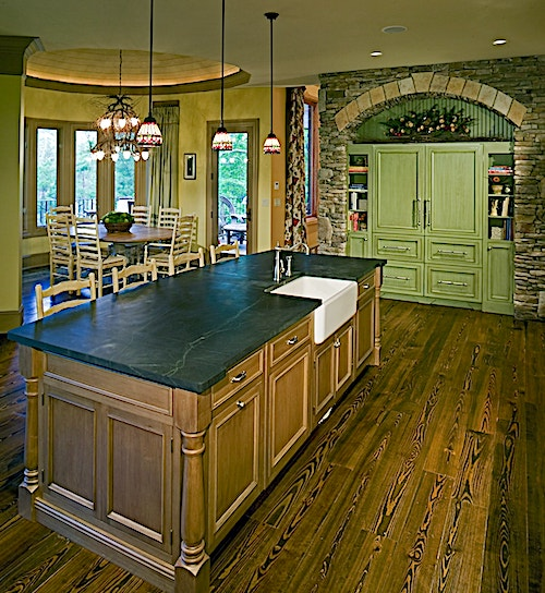 Gorgeous kitchen with a center island, breakfast nook, and abundant cabinets