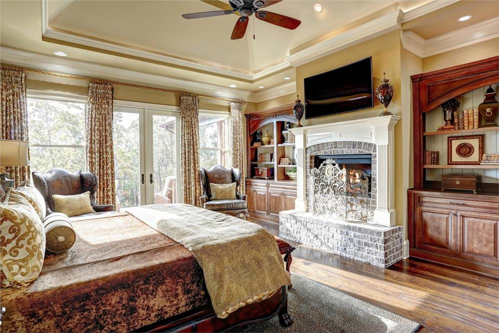 Bedroom with tray ceiling and detailed decorative trimwork
