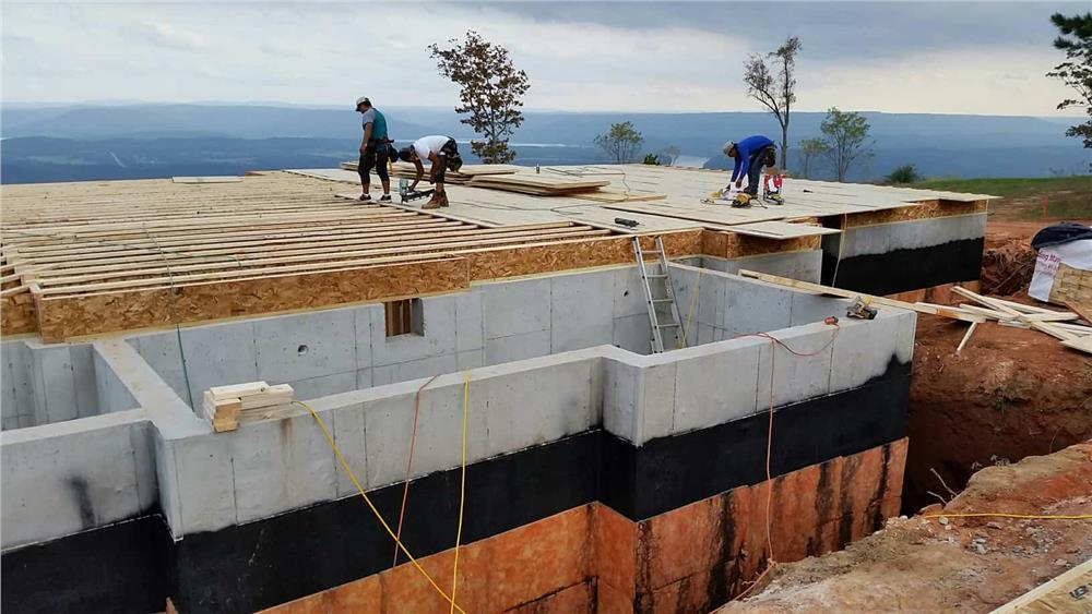 Floor joists being installed on a foundation