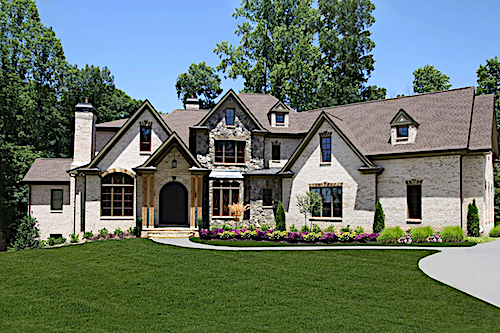 Large European style home with brick and stone siding