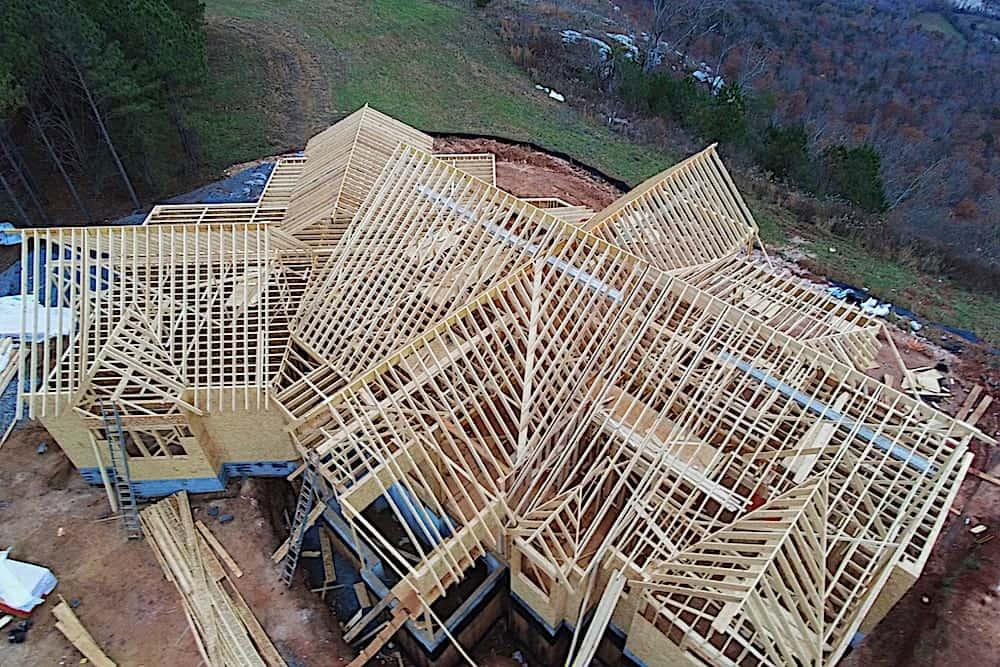 Aerial view of a framed house showing the rafters in the roof sturcture