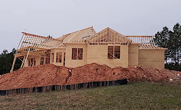 House under construction with wall sheathing attached