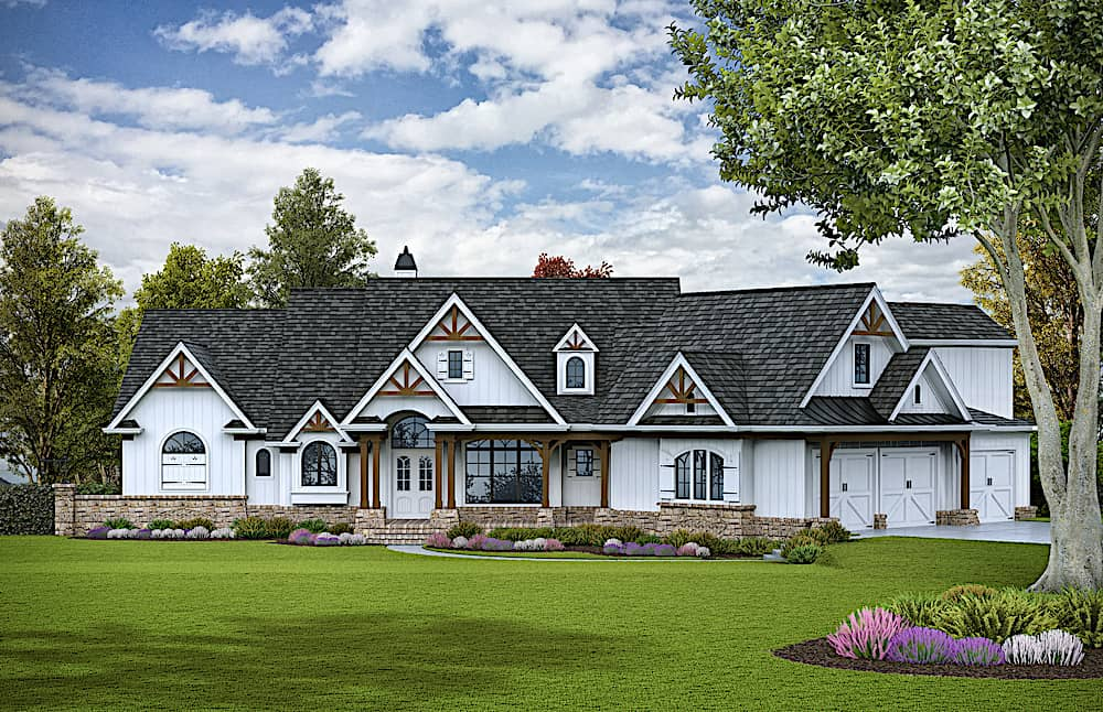 Luxury Cottage style home with board-and-batten siding and stone and timber accents