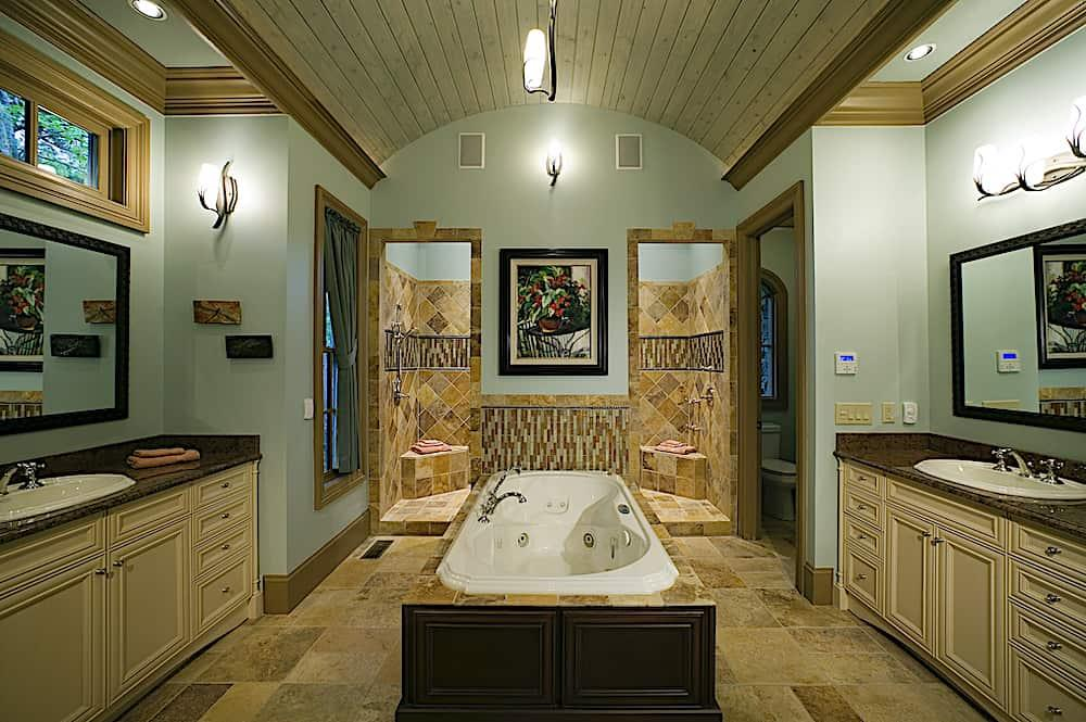 Distinctive barrel-vaulted ceiling in the luxurious master bath of a  Country style home.