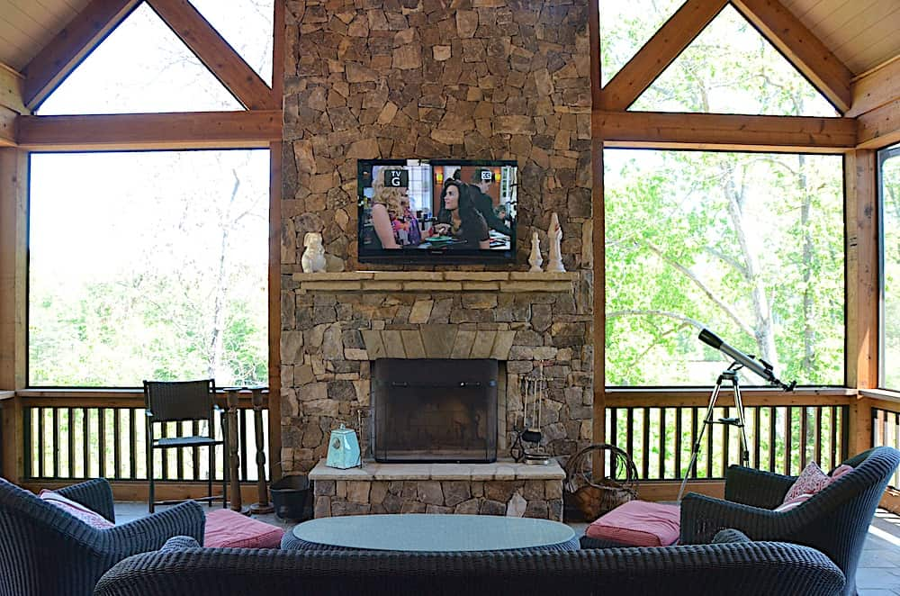 Stone fireplace and chimney with wood beam detailing