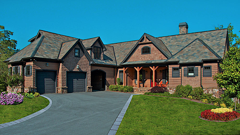 Rustic luxury home with wood siding and complex rooflines