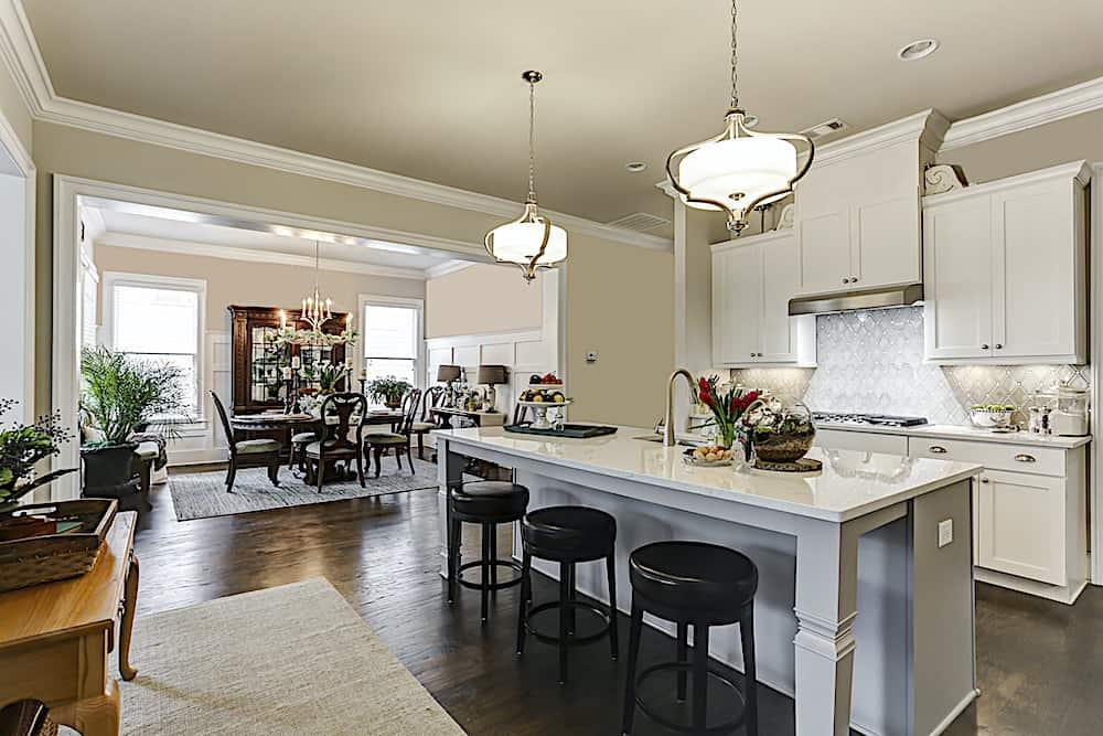 Kitchen and dining room that show off decorative architectural white trim work