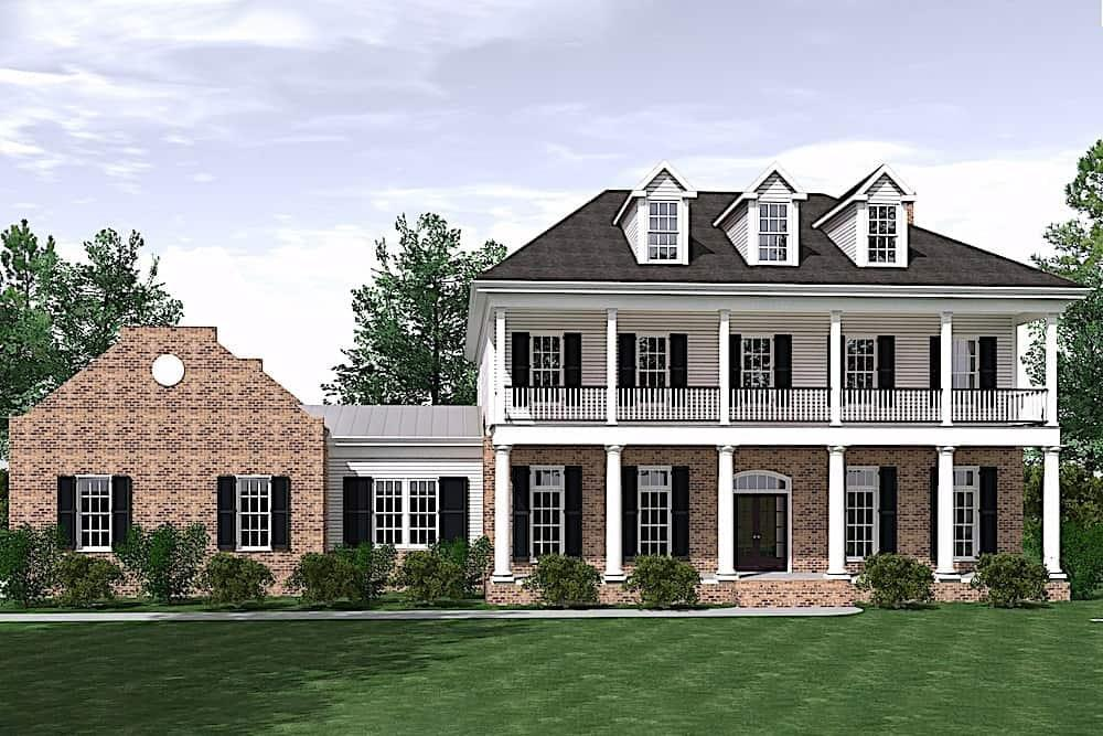 Colonial home with two-story front porch and hip roof with three gable dormers