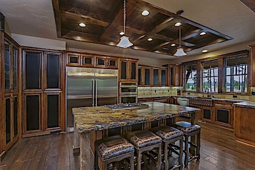 L-shape kitchen with stainless steel accents and wood floor