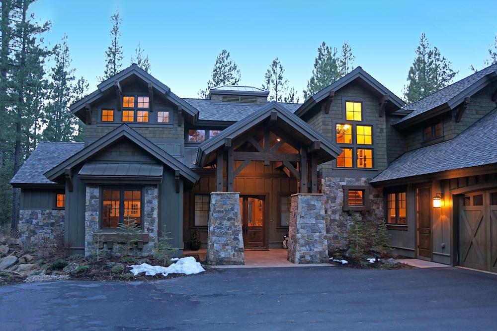 Front entry door of luxury home showing massive stone bases for portico roof columns