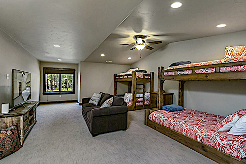 Bunk room with two bunk beds and sitting area