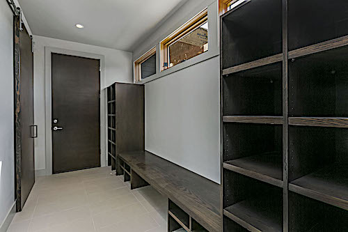 Mudroom from the garage entry with lockers and bench