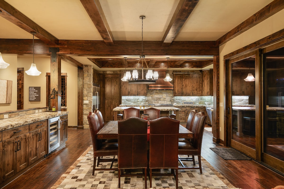 Kitchen in rustic style home with dark wood flooring, cabinets, and ceiling beams