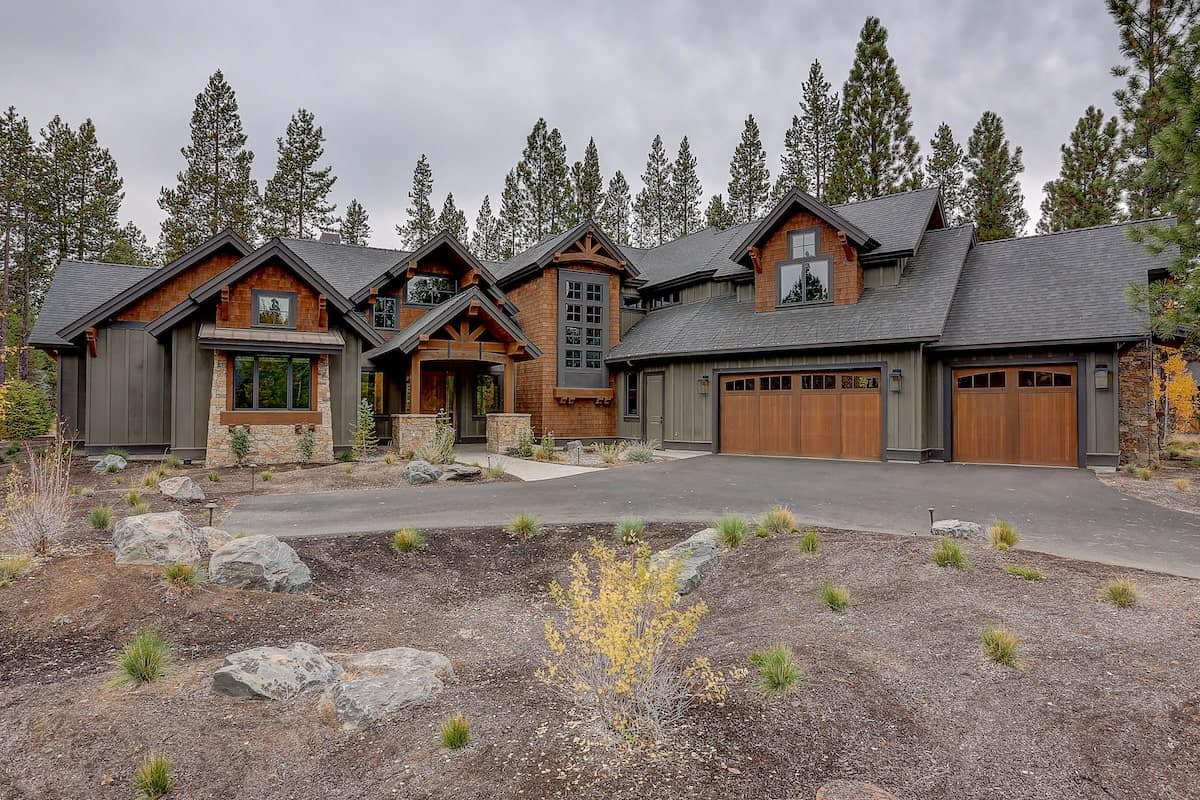 Rustic style home with exposed timbers and wood siding