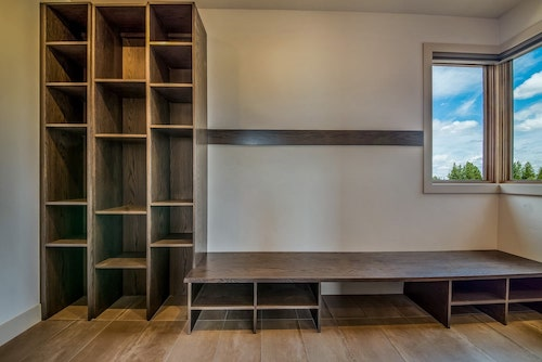 Mudroom with shelves, bench, and cubbies