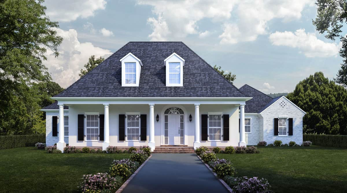 Luxury Colonial style home with white siding and colonnaded porch