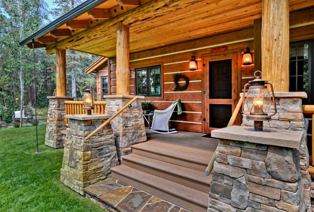 Front porch of log cabin showing stone column bases and fine workmanship