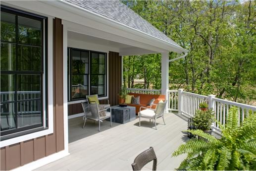 Clean and sunny porch and deck.