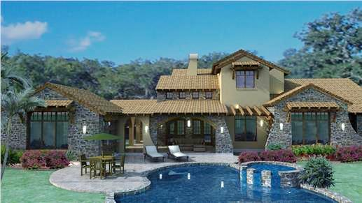 Rear view of luxury Tuscan style home plan with swimming pool