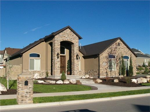 Tusan style home with beautiful use of stucco, rock and stone.