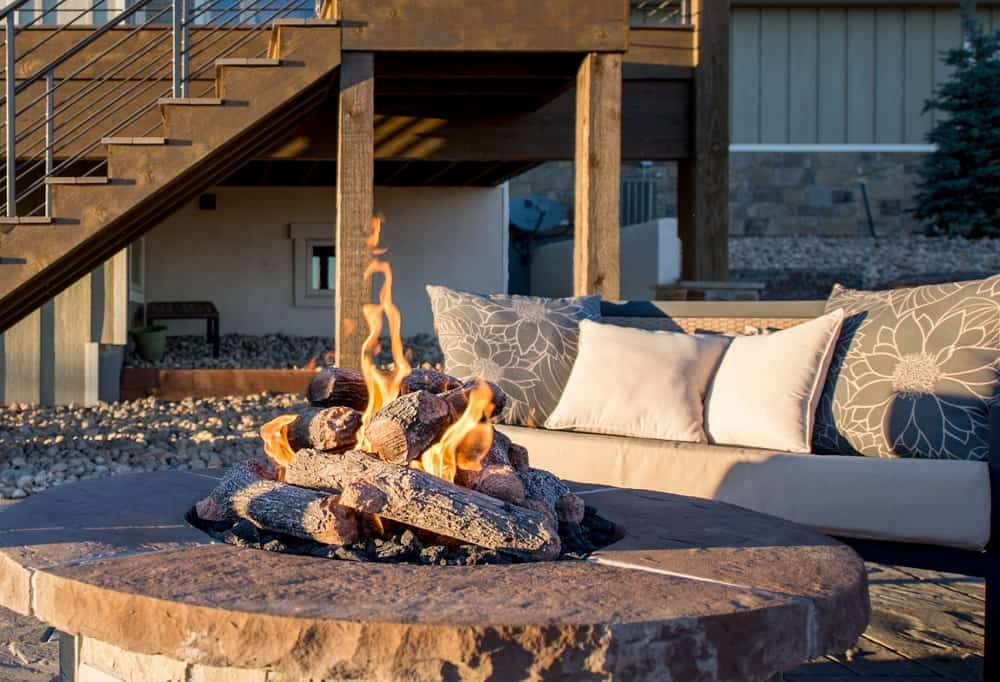 Cushions on this sofa make the area around the fire pit more exciting.