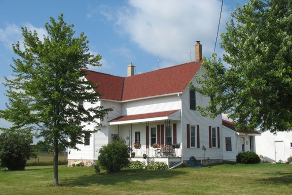 Restored Farmhouse with Porch and Gabled Roof