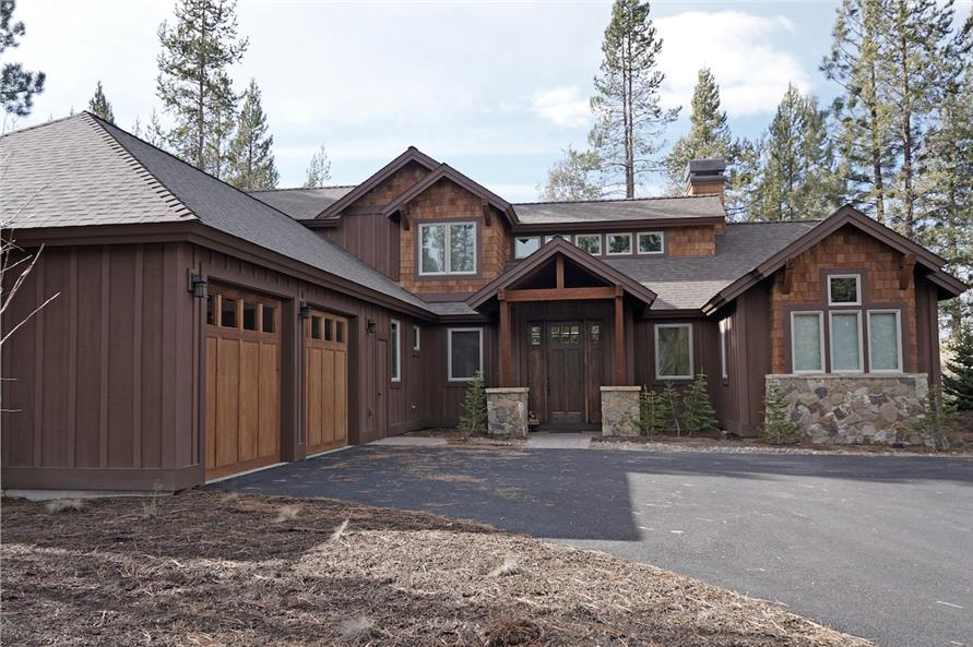 L-shaped 3-bedroom, 3.5-bath Rustic home with a courtyard entry