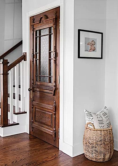 Vintage door dresses up a mundane coat closet