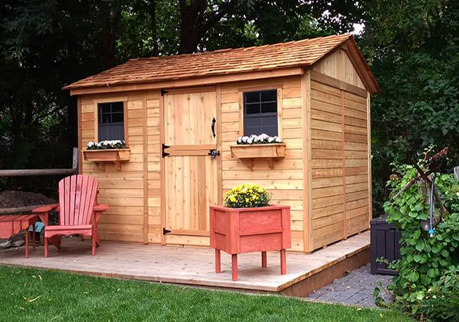 Charming ready-to-build shed kit with flower boxes