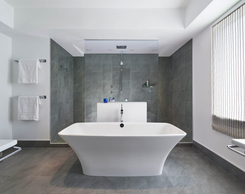 Standalone tub flairs at the top, making it easier to step into the tub or sit on the edge and swing your legs into it