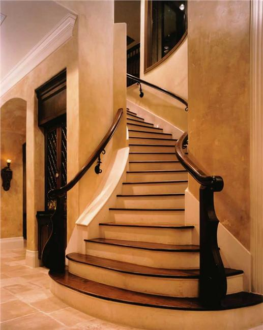 Foyer with dramatic staircase.